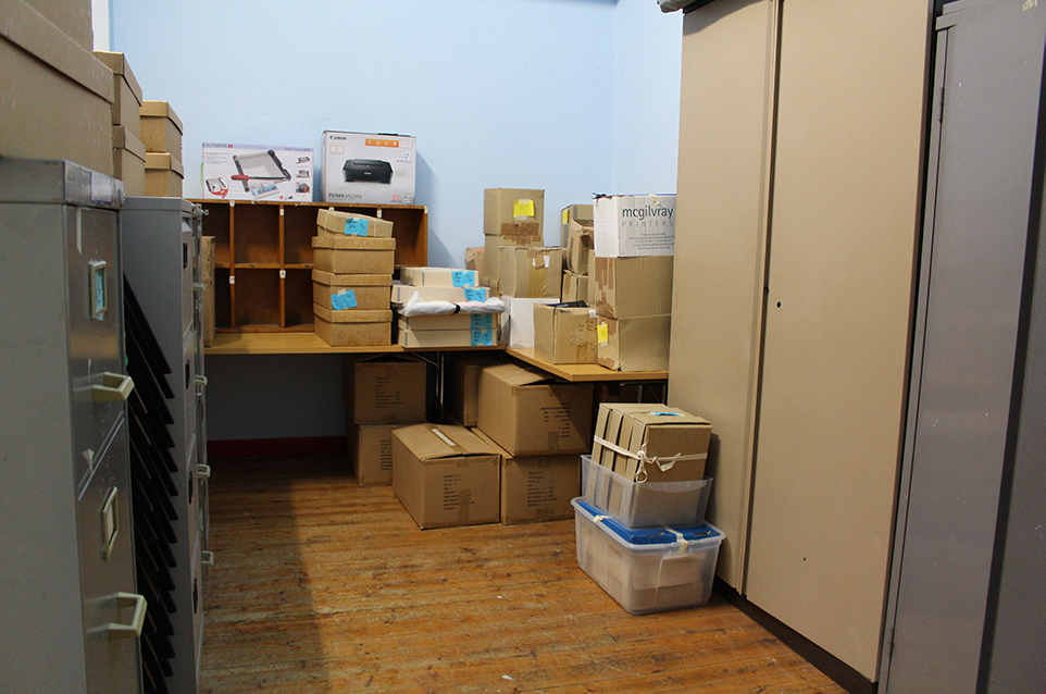 Archives and books waiting to be unpacked in the new office.